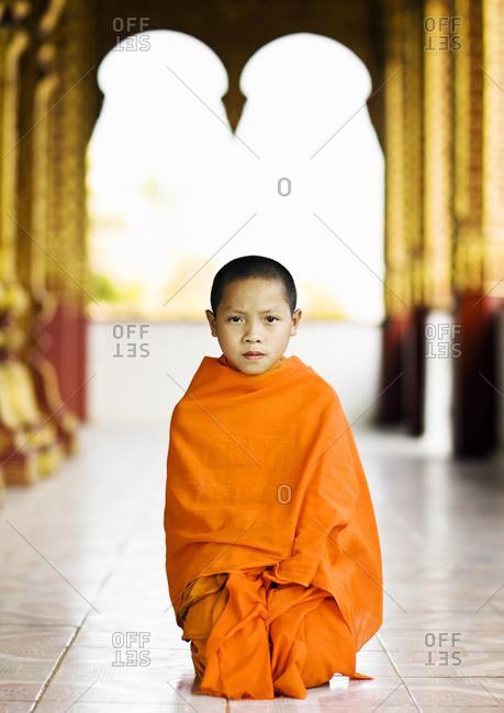 Luang Prabang, Laos - January 30, 2009: A portrait of novice monk at Wat Manoran, Luang Prabang, Laos