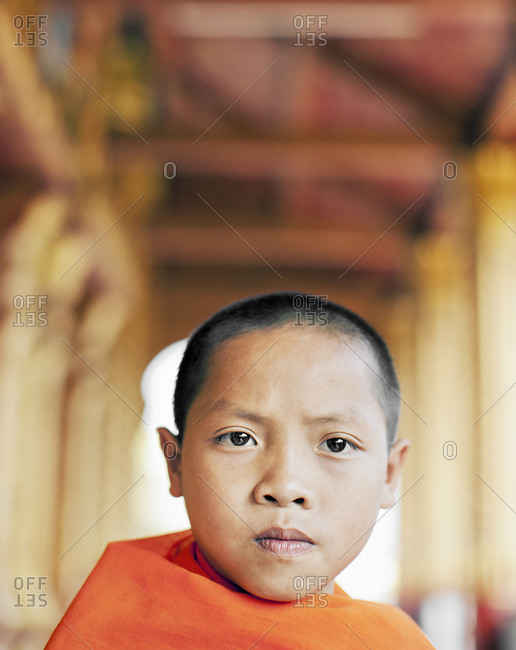 Luang Prabang, Laos - January 30, 2009: Portrait of novice monk at Wat Manoran, Luang Prabang, Laos