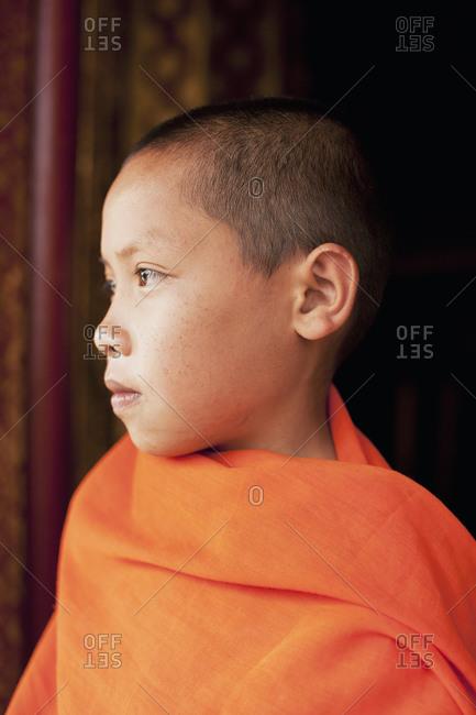 Luang Prabang, Laos - January 30, 2009: Novice monk at Wat Manoran, Luang Prabang, Laos