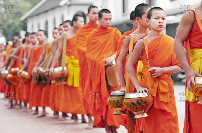 Luang Prabang, Laos - February 3, 2009: Monks processing for alms at sunrise, Luang Prabang, Laos