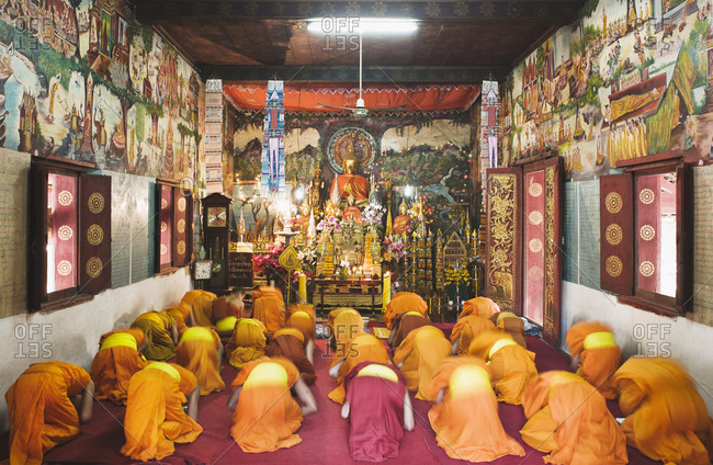 Monks reciting their early evening chants in Wat Mouenna, Luang Prabang, Laos