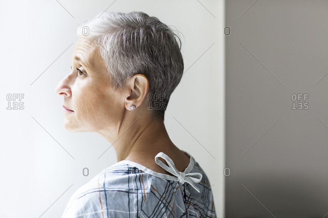 A hospital patient looks out of a window