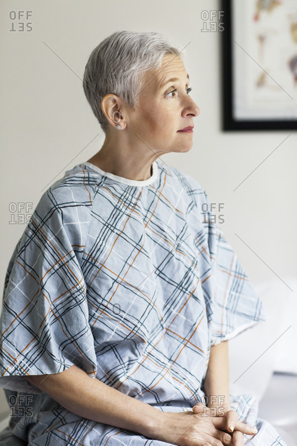 A hospital patient sits on an exam table