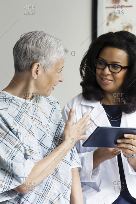A woman discusses her diagnosis with her doctor