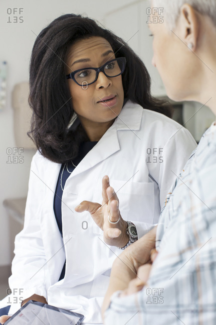 A doctor talks with her patient