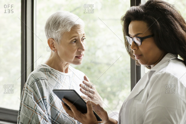 A patient discusses her prognosis with her doctor