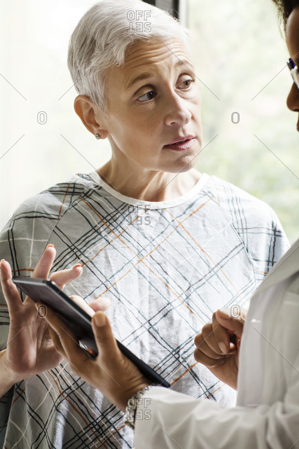 A patient discusses her prognosis with a doctor