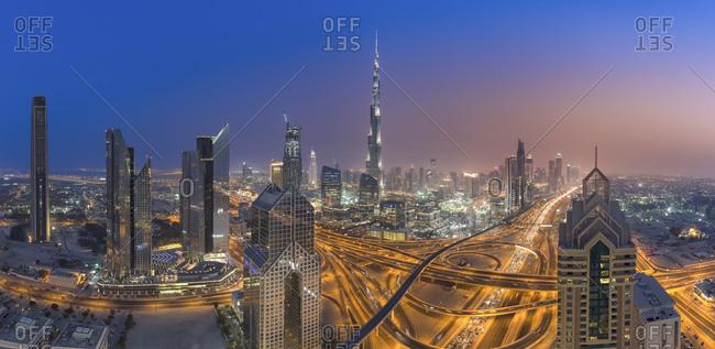 Dubai, UAE: June 30, 2015: Interchange at Sheikh Zayed Road and Dubai skyline at dusk