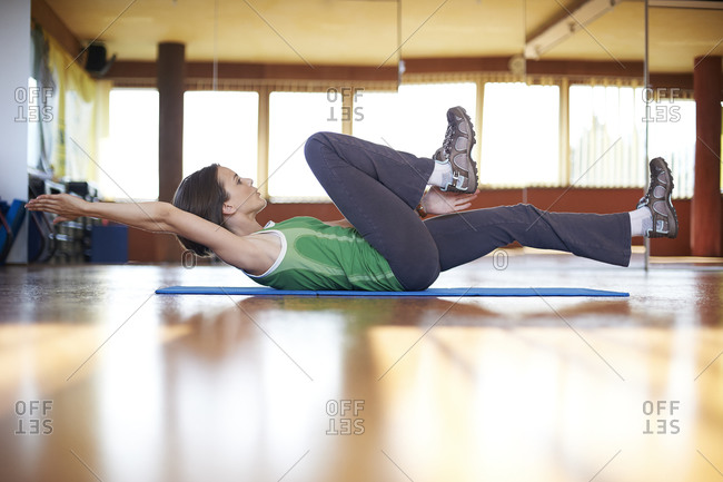 Woman in fitness studio doing abdominal training