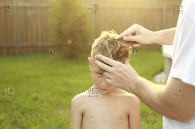 Father giving his son a haircut