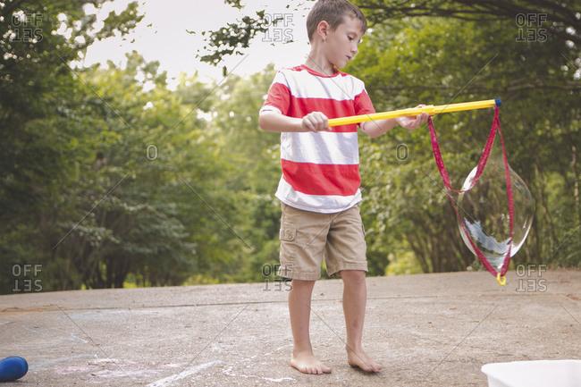 Little boy holding a bubble wand