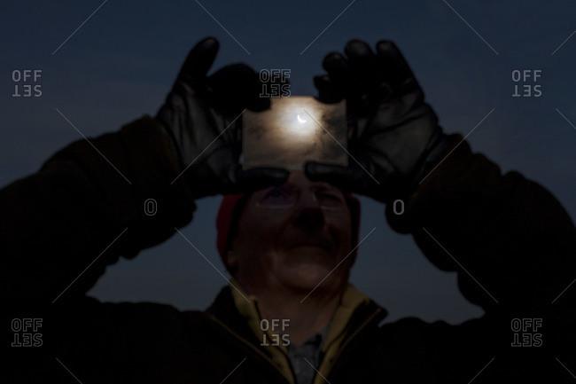 Man watching a solar eclipse
