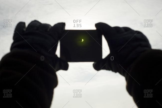 Solar eclipse viewed through a welding glass