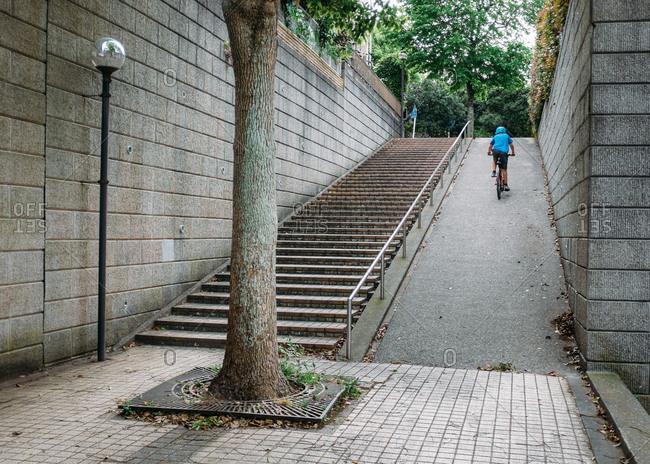 Kid riding bike up ramp in park