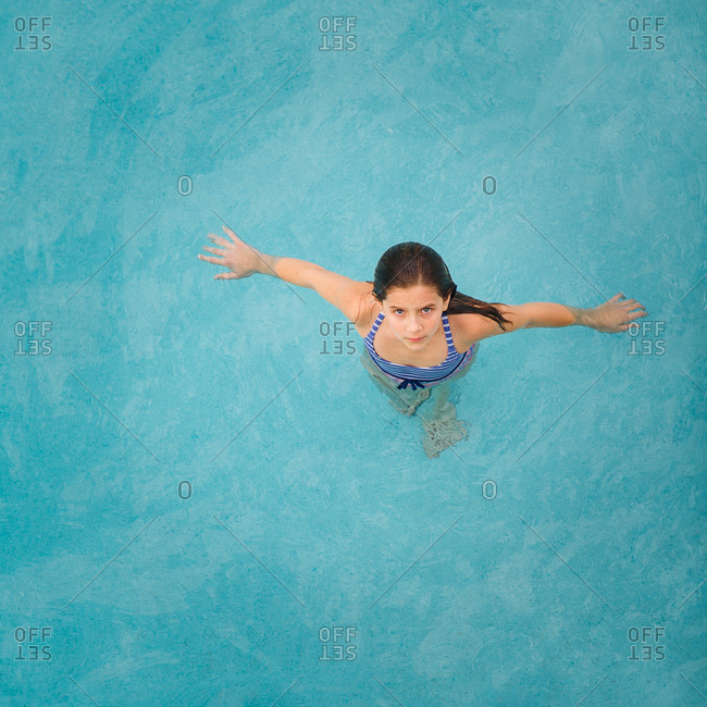 Overhead view of girl standing in pool
