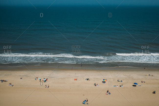 Beach goers on a beach from above