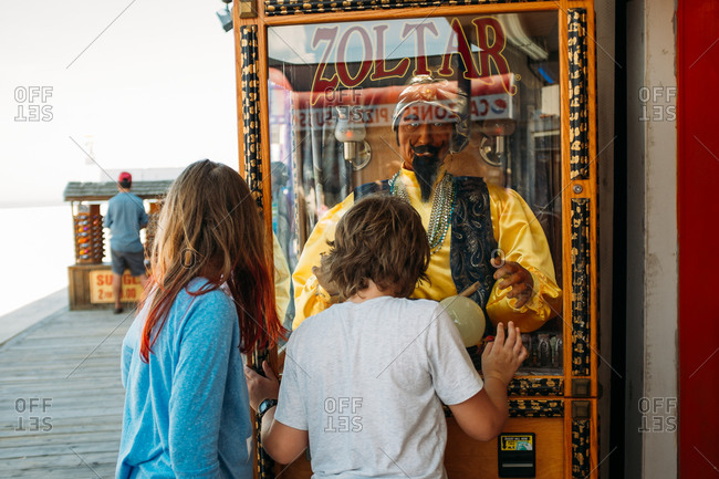 Ocean City, Maryland - May 30, 2015: Kids at the  Zoltar machine at Ripley's Believe It or Not