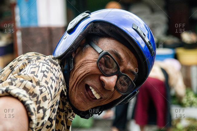 Yogyakarta, Indonesia - May 29, 2015: Smiling motorcyclist