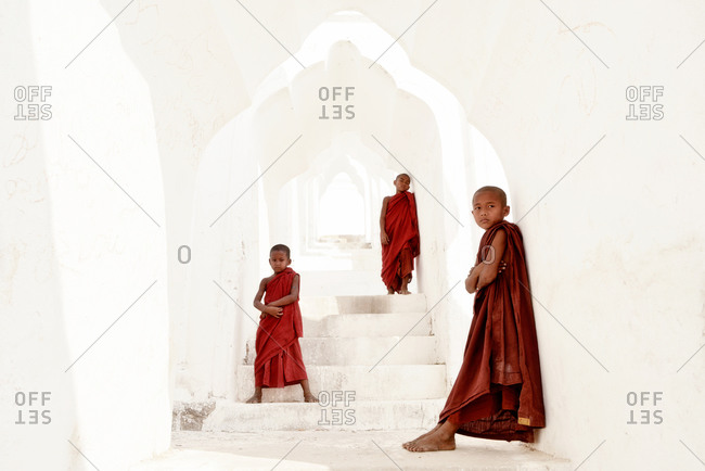 Mingun, Myanmar - March 1, 2015: Young monks at the entrance of Hsinbyume Pagoda
