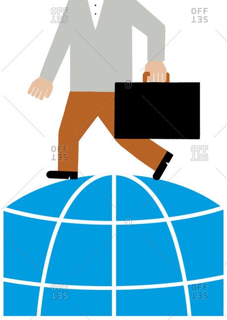 A businessman carries a briefcase atop globe