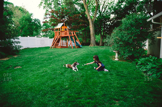 Girl and dog in backyard
