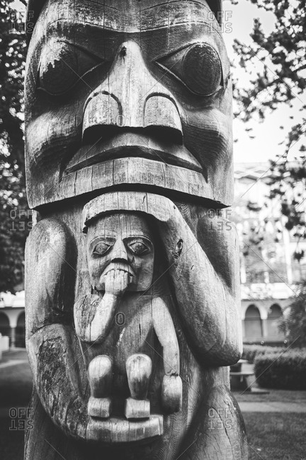 A carved wooden totem pole in Victoria, Canada