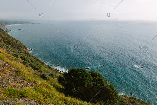 Vast sea off rugged coastline