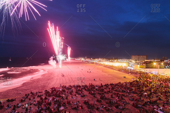 Crowds watching fireworks on the beach
