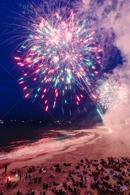Crowds watching fireworks on beach
