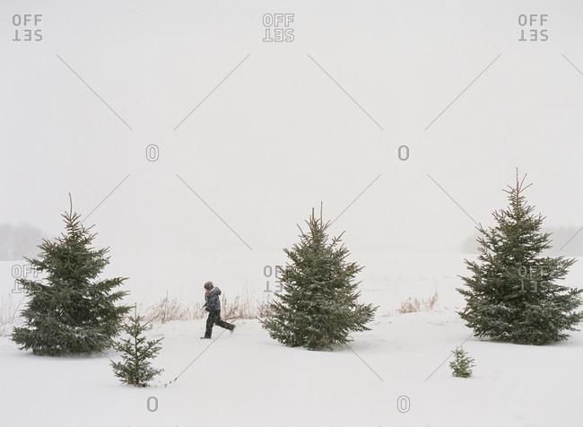 Boy running in snowy landscape