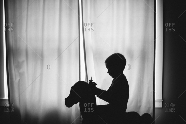 Boy sitting on a rocking horse
