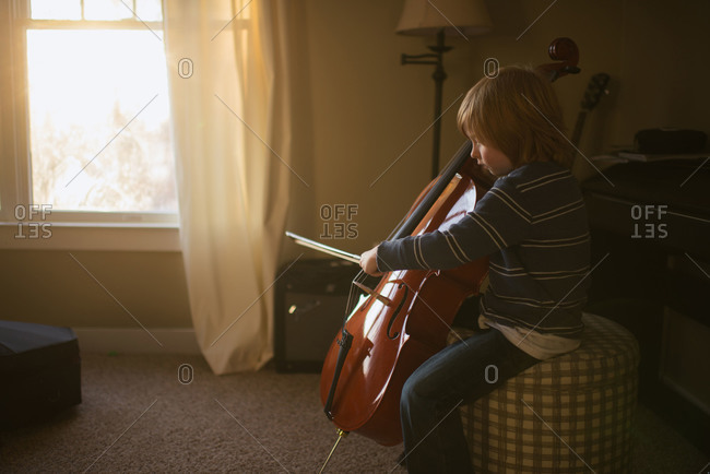 Little boy playing the cello