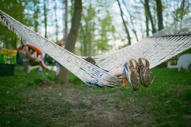 Boy swinging in a hammock