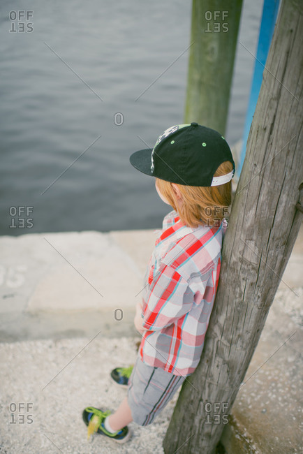 Red haired boy looking out at water