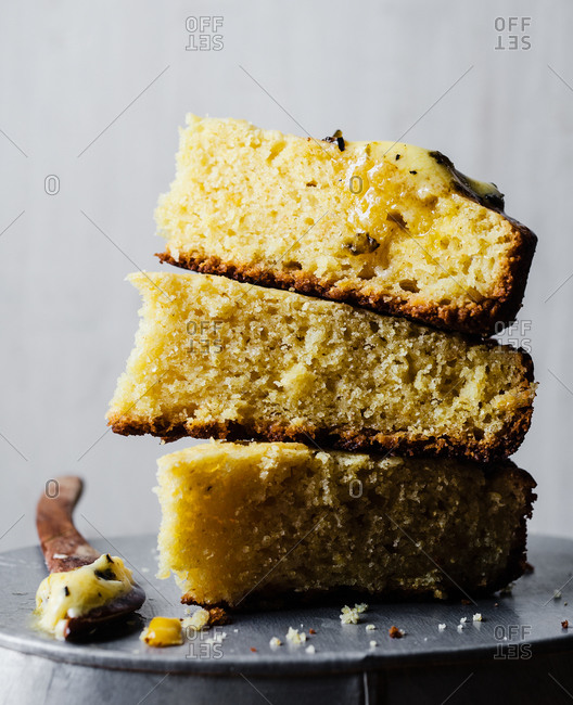 Stack of cornbread wedges with herb butter