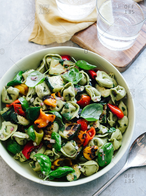 Tortellini pasta salad with grilled vegetables and basil