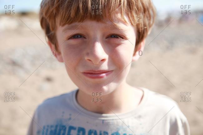 The face of a boy on the beach