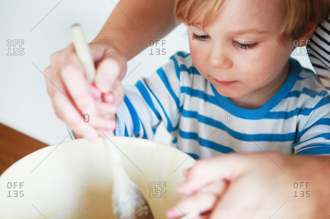 A mother and son bake together
