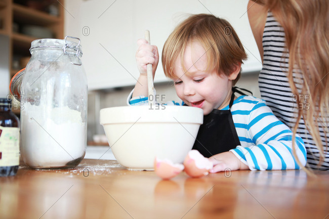 A son bakes with his mother