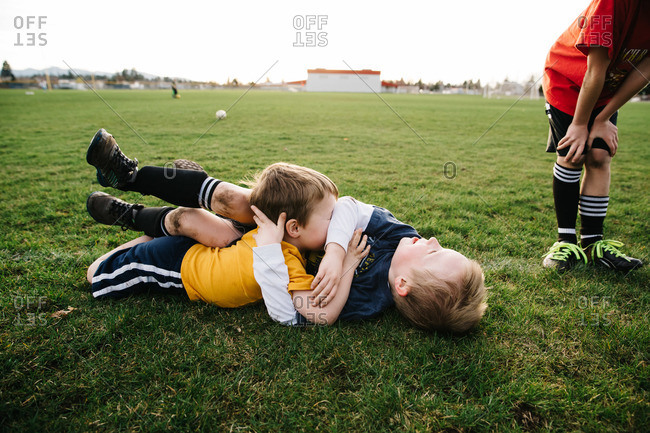 Boys wrestling during soccer practice