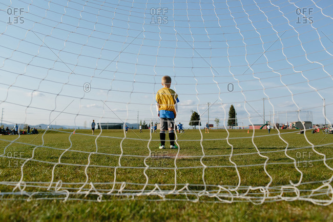 A boy plays goalie during a soccer game