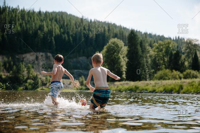 Two boys play in the Saint Joe River