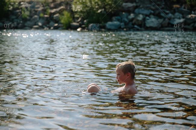A boy swims in the Saint Joe River, Idaho