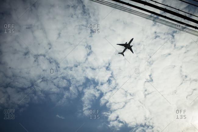 Plane flying overhead against cloudy sky