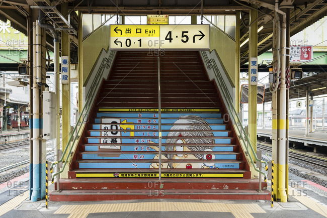 Japan - June 8, 2014: Steps leading to elevated rail station, Japan
