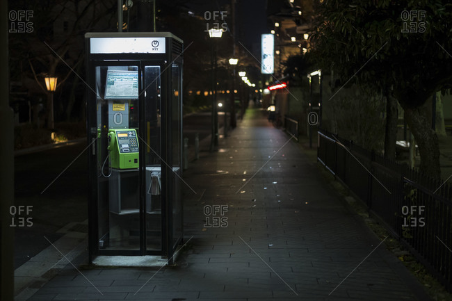 Japan - January 17, 2015: Phone booth at night in Japanese street