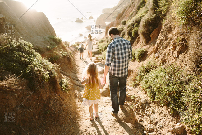 Family walking down to the beach