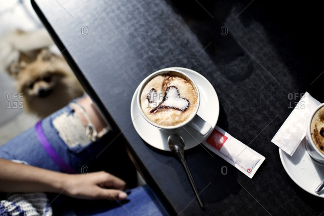 Overhead view of a cappuccino with heart design made of sugar in the foam