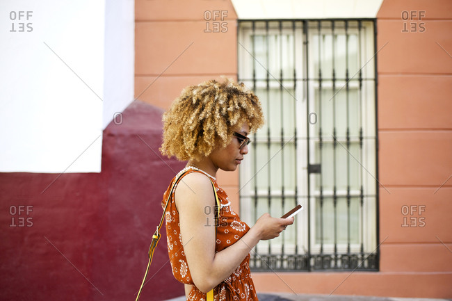 Woman walking while using smartphone