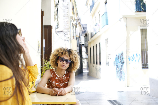 Two women sitting at European outdoor caf_